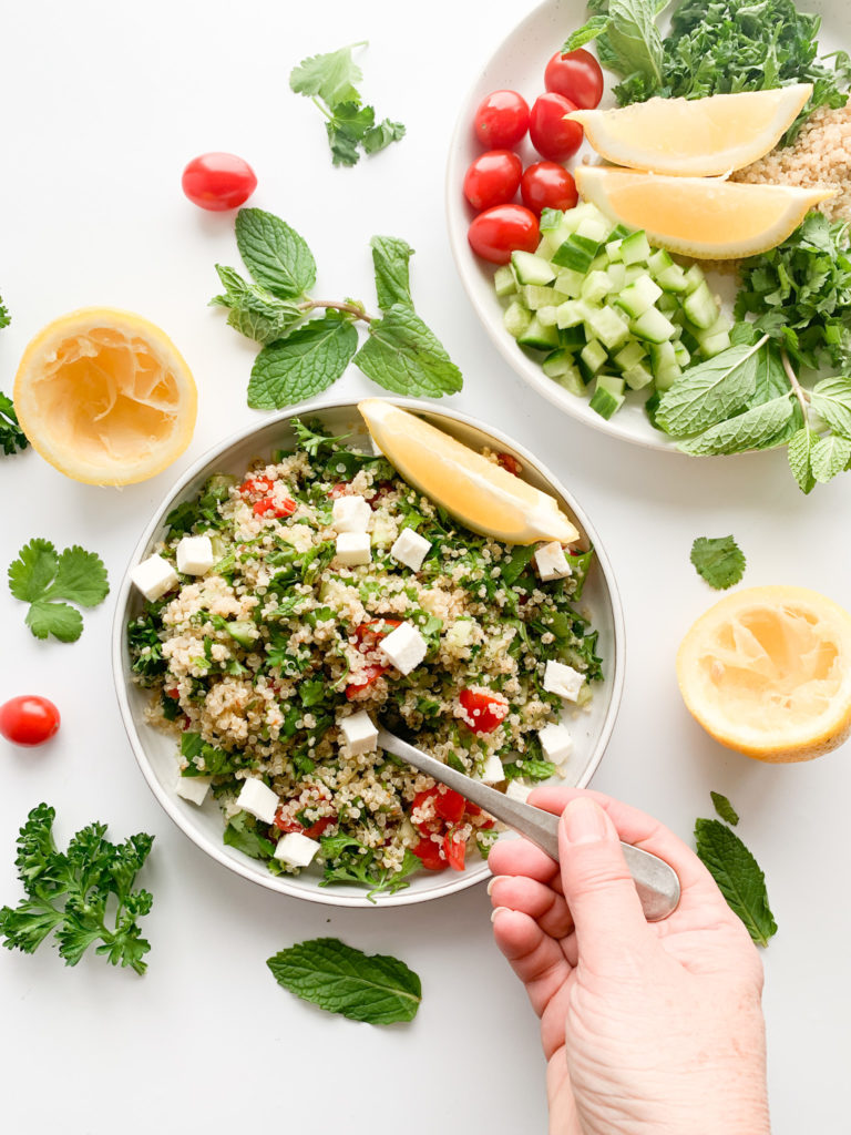 A healthy gluten-free quinoa salad made with simple ingredients and a bunch of fresh herbs.