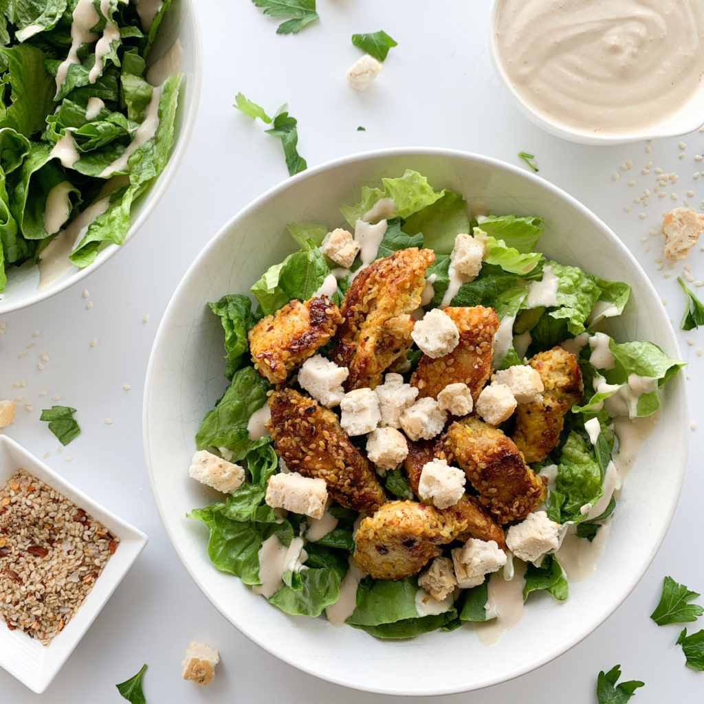 This homemade gluten-free spicy Chicken Caesar salad is packed with flavour, spice and crunch. This salad would also work as a filling in a wrap for lunch or a picnic.