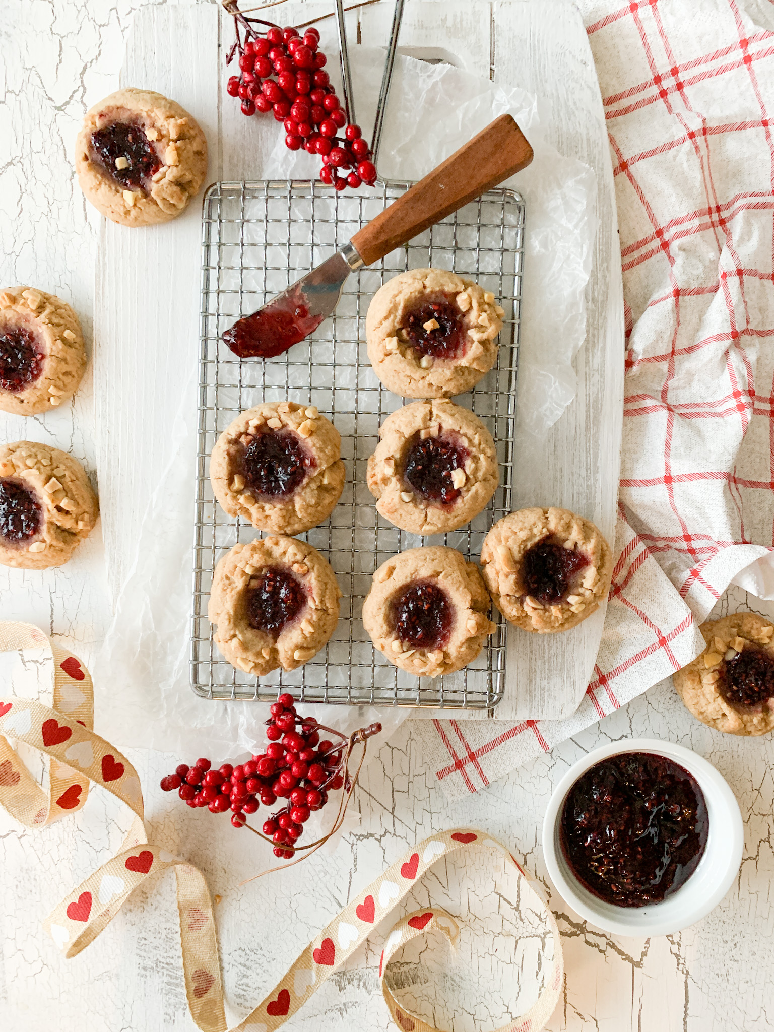 A gluten-free peanut butter and jam sandwich made into a cookie.