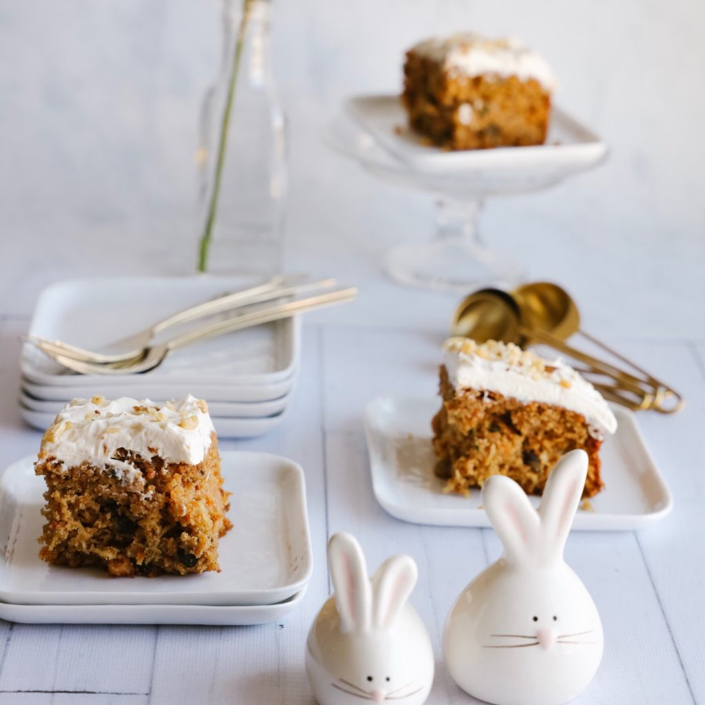 This delicious and easy to make gluten-free carrot cake is moist and fluffy and topped with a creamy cream cheese frosting. This no-fuss cake is the perfect dessert for Easter and springtime.