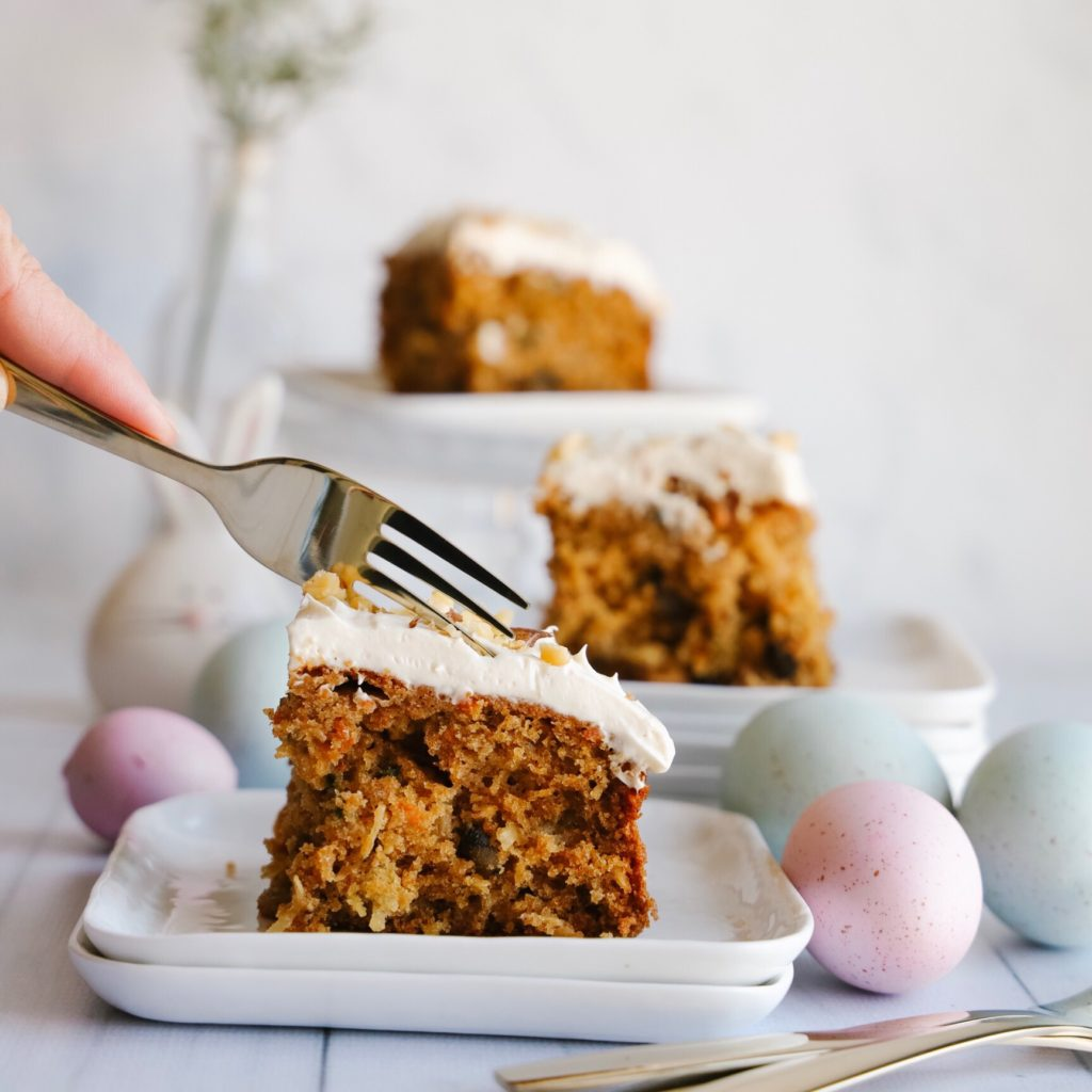 This delicious and easy to make gluten-free carrot cake is moist and fluffy and topped with a creamy cream cheese frosting. A no-fuss cake perfect for Easter and springtime.