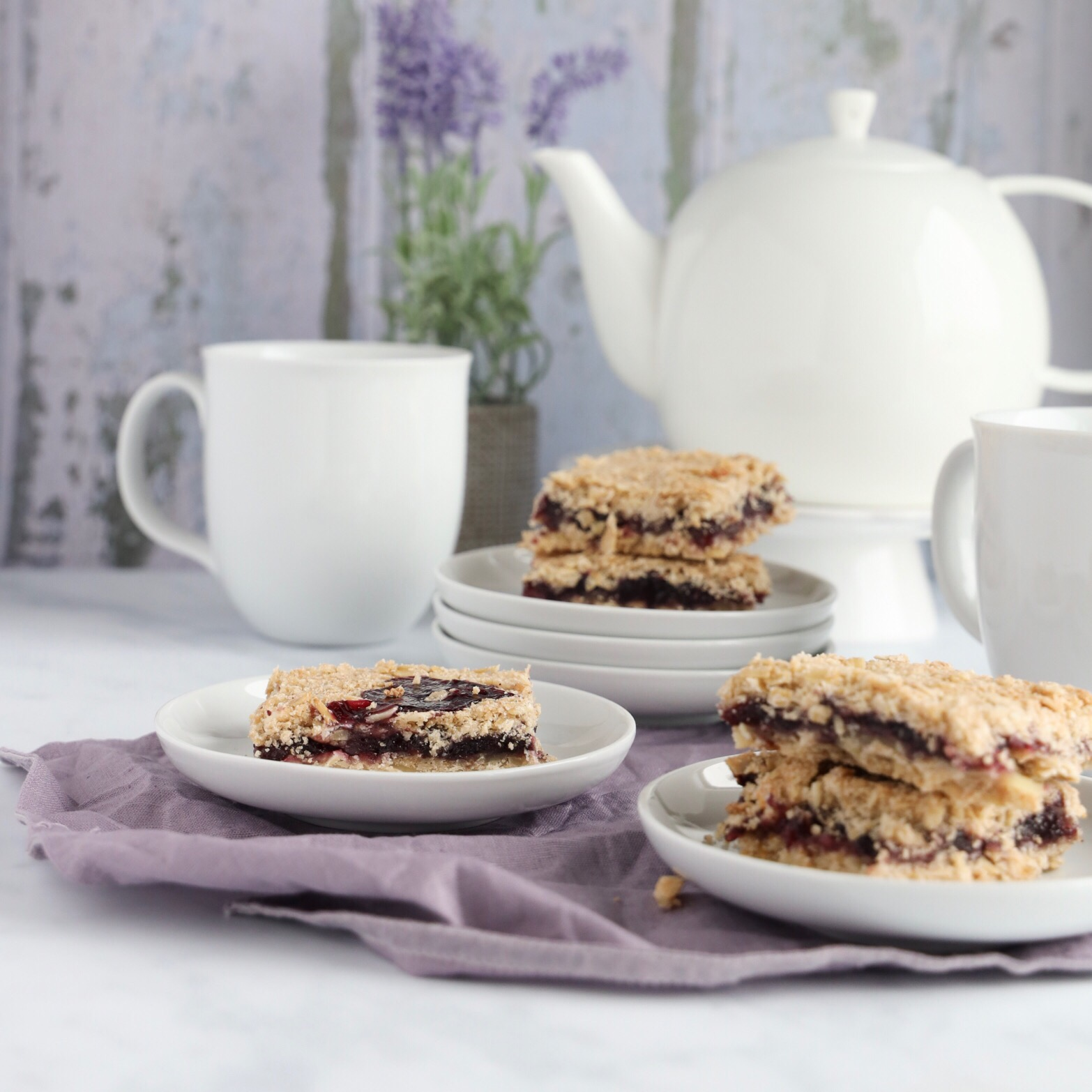 These gluten-free blueberry crumb bars are made with organic blueberry jam and has a buttery crust and crumbly topping.
