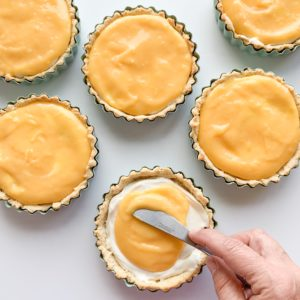 Keto and gluten-free no bake lemon curd cheesecake tarts that are tangy and delicious.